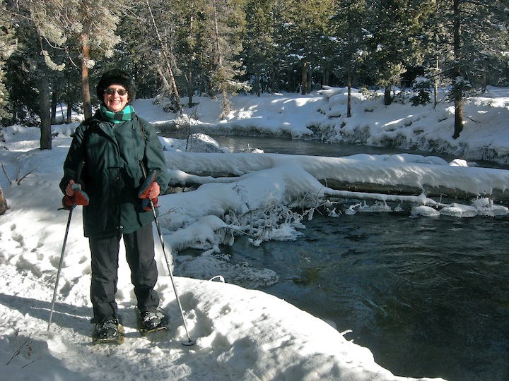 On snowshoes by the Firehole River